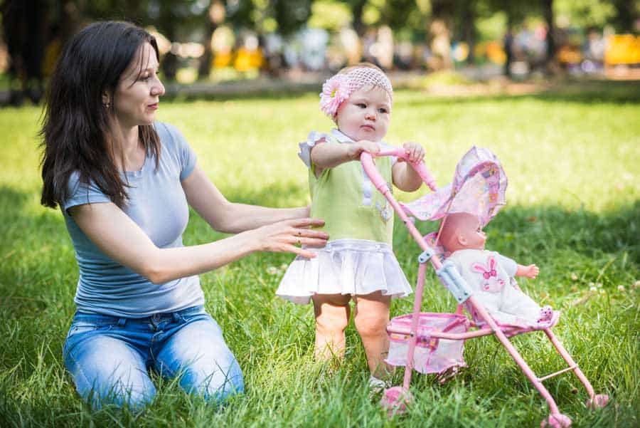 mother and daughter with doll