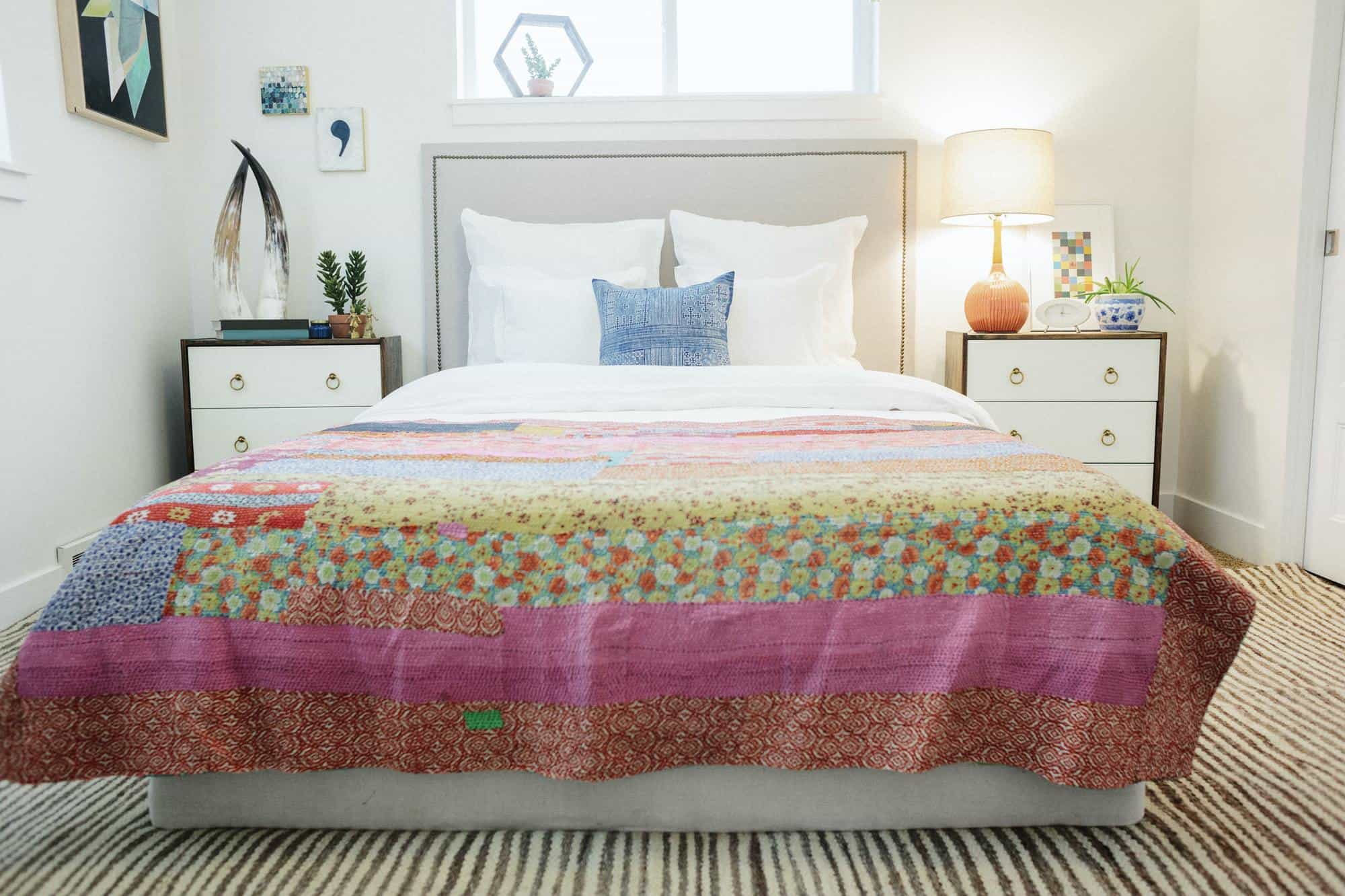 Double bed with patchwork quilt