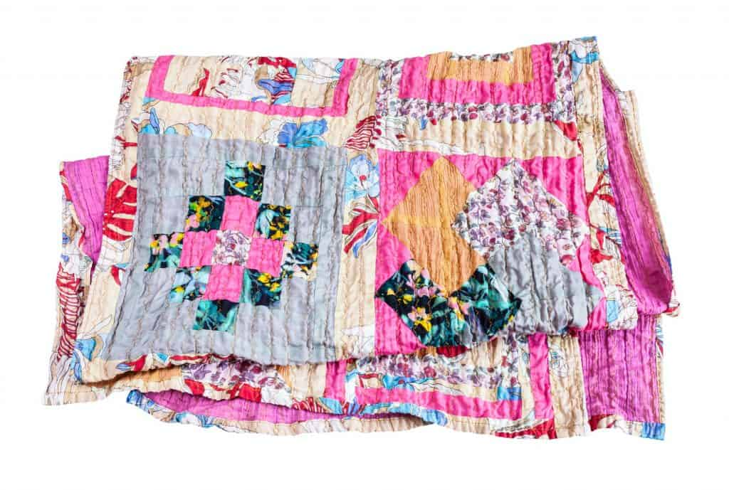 folded patchwork shawl from various silk strips