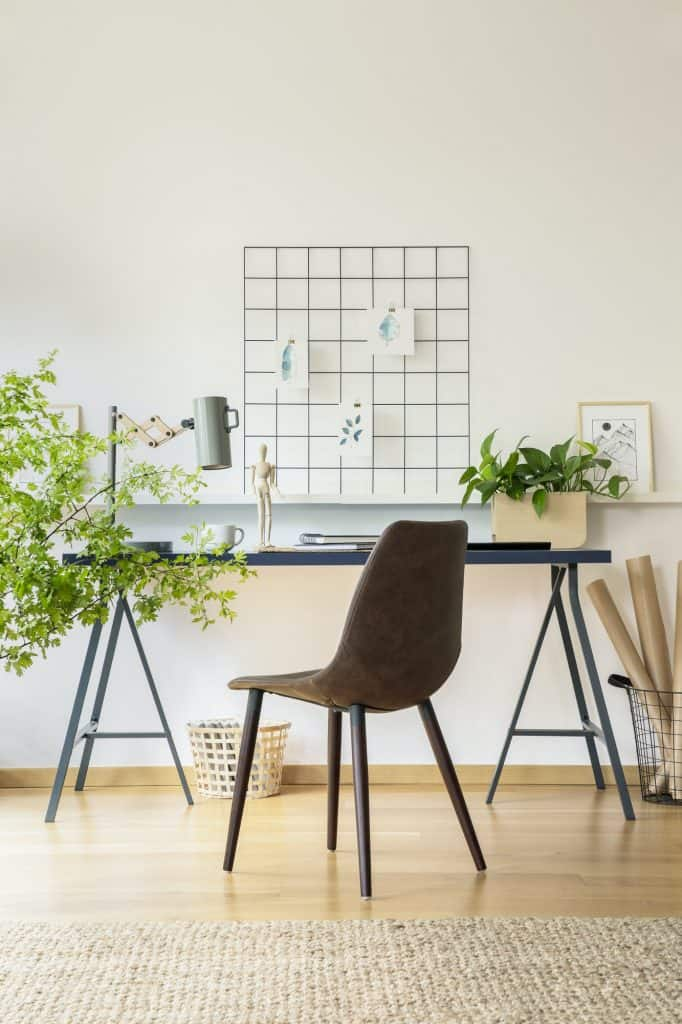 Real photo of workspace desk with notebooks, metal lamp and fres
