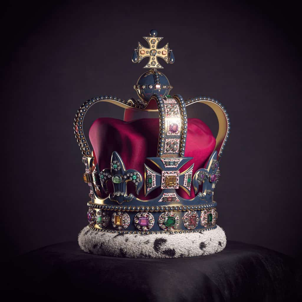 Royal golden crown with jewels on pillow on black background. Symbols of UK United Kingdom monarchy.