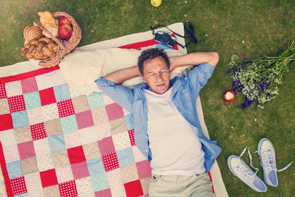 Senior man having a picnic