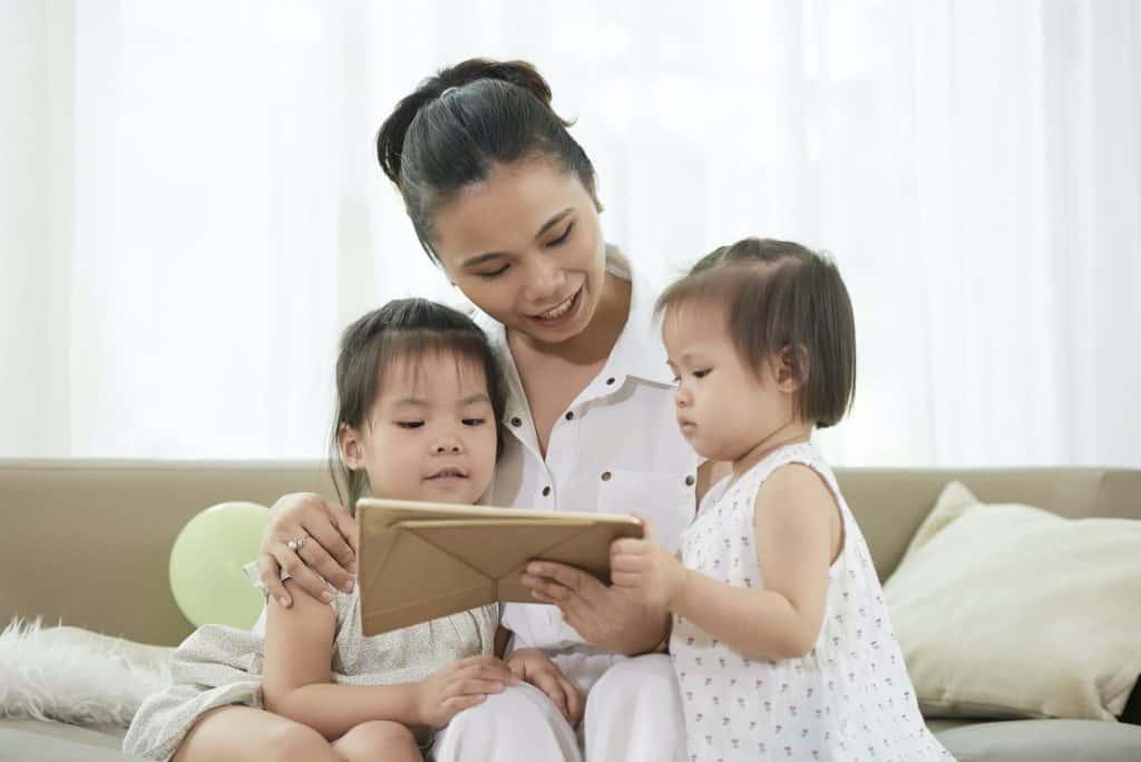 Woman Showing Educational Cartoon to Children